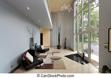 Modern foyer with two story windows