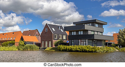 Modern free standing houses at waterfront - Modern free...