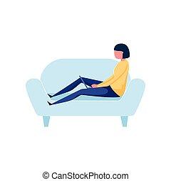Modern freelancer woman working on laptop at soft sofa