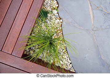 Combinations of plants, timber decking, paving and rocks