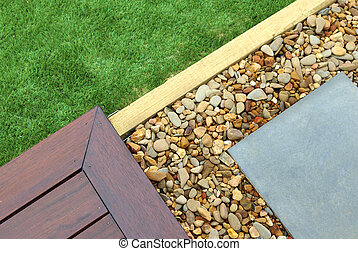 Combinations of timber decking, paving, artificial grass and pebbles