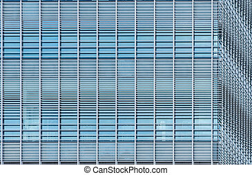 Modern futuristic glass building abstract background. Exterior of office glass building architecture. Facade of sustainable business building. Energy saving architecture. Glass window of company.