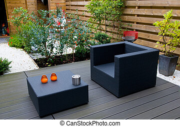 Modern garden - Modern garen with grey furniture flowers and...