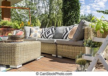 Modern garden patio with rattan sofa