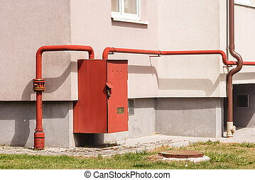 gas distributor on the wall of the house