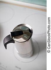 Modern geyser coffee maker on induction cooker - A modern...