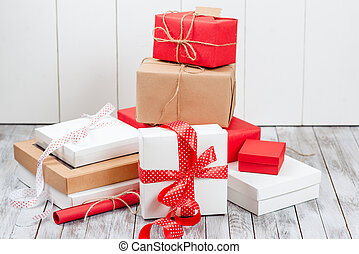 Modern gift boxes over wooden background.