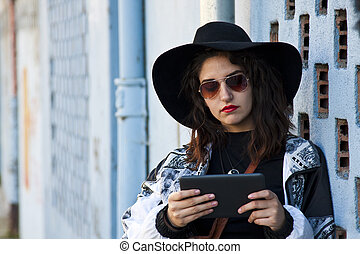 modern girl with the tablet on the street