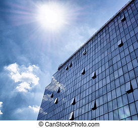 Modern glass and steel - business building with striking sky in background