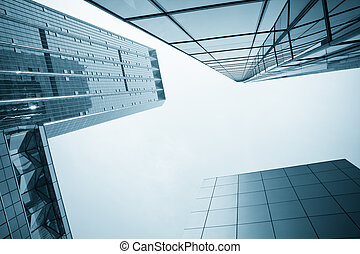 modern glass office building with blue tone