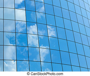 Modern glass skycrapers background with sky and clouds ...