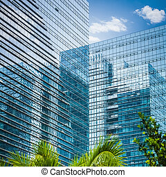 modern glass skyscraper, exterior of glass wall with ...