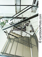 Modern glass staircase in apartment