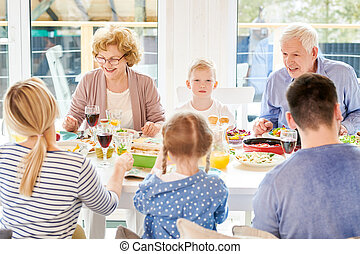Modern Grandparents Enjoying Family  Dinner