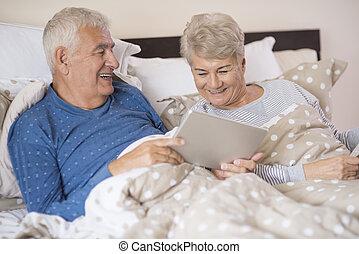 Modern grandparents resting in the bedroom