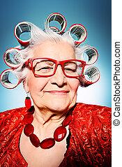 modern granny - Portrait of an elderly woman in curlers ...