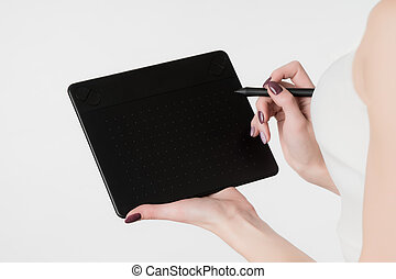 Modern graphic tablet in hand of the girl