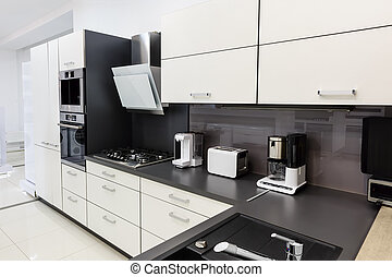 Modern luxury hi-tek black and white kitchen interior, clean design