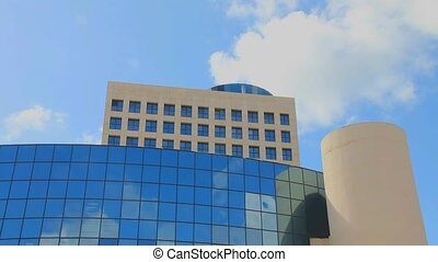 modern high-rise public building - White clouds on blue sky...