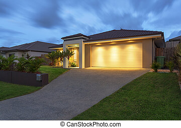 Modern home at dusk - Well lit modern home exterior at dusk