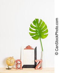 Modern home decor with blank sheet of paper on a clipboard
