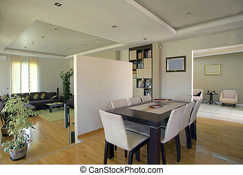 Interior of a modern house, rooms in white with furniture.