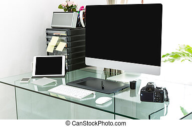 Modern home office with computer and laptop