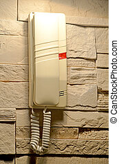 Modern home phone hanging on the wall