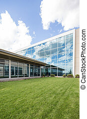 Modern Hospital Building With Glass Windows - Exterior of...