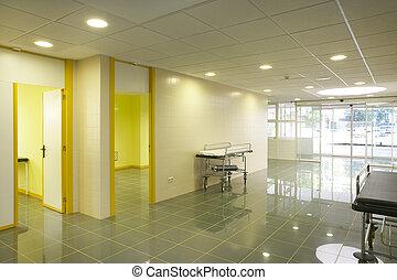 Modern hospital emergency entrance in yelow tone