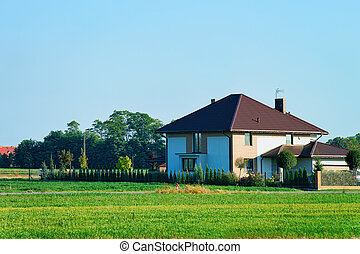 Modern house and fence in village in Poland