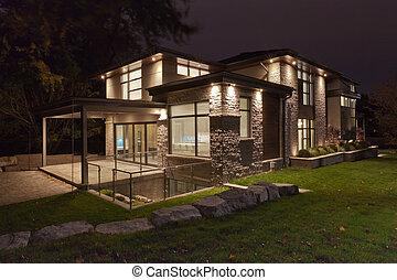 Backyard of a modern house at night