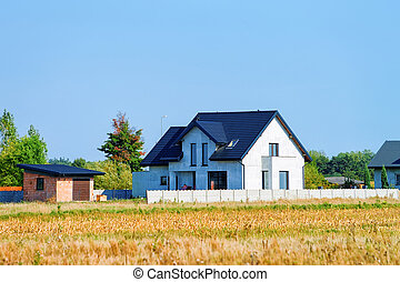 Modern house with fence in village in Poland
