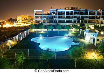 Modern house with pool, night scene