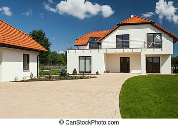View of beautiful modern house with separate garage