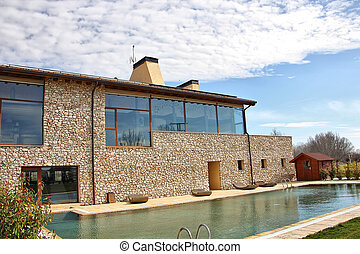 Modern house with windows and large pool