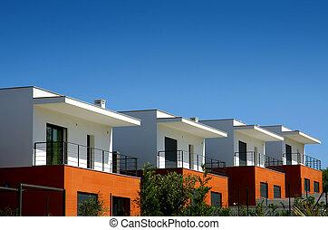 Modern Houses - Facades of a modern houses condominium in a...