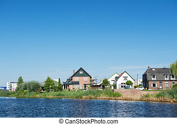 Modern houses in Holland near the river