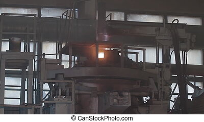 Modern induction furnace with liquid metal. Molten metal melted in furnace at metallurgical plant. Iron and Steel Works. Converter plant. Smelting of metal.
