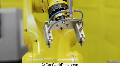 Modern Industrial automation. Robotic Arm Assembling products