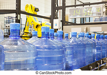Modern industrial shop on pouring mineral water