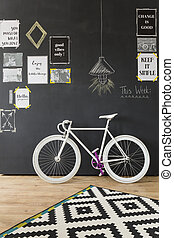 Modern interior design with bicycle with white wheels and...