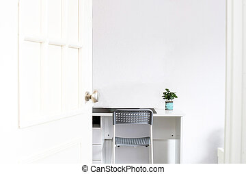 Modern interior in the style scandinavian, a place for study. with a green plant on a desk