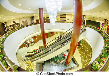 modern interior of a luxury hotel with escalators