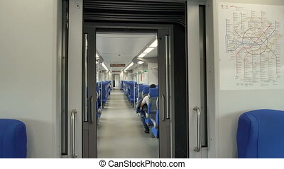 modern interior of the high-speed train swallow with passengers on seats