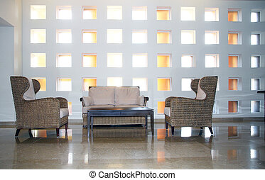 Modern interiorwith a sofa, coffee table and chairs