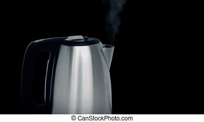 Modern Kettle Boiling - Modern metal kettle boiling with...