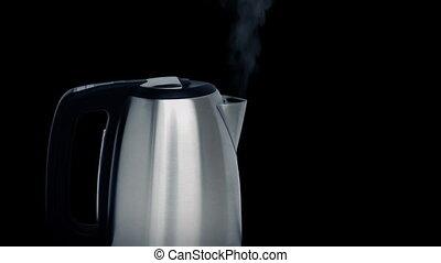 Modern Kettle Boiling - Modern metal kettle boiling with...