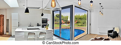 Modern kitchen from loft with view on a lush garden