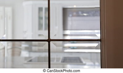 Modern Kitchen interior. Shot through window